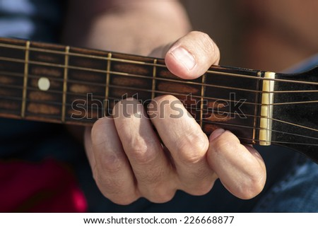 Left hand position of basic chord on the old classic guitar