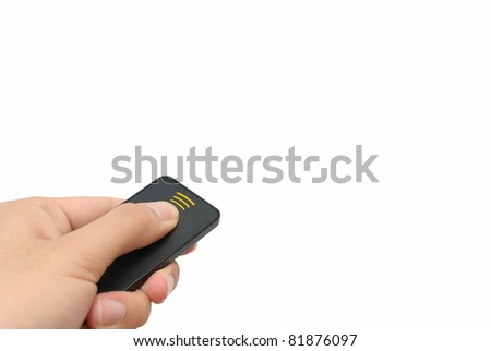 Left hand using remote against white background