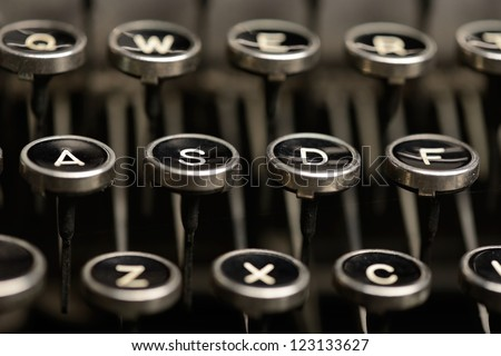 Left home row keys on an antique typewriter. Close-up of the left half of home row keys on an old typewriter. Shallow DOF.
