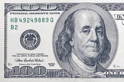 left side of a hundred-dollar bill USA with a portrait of American President Benjamin Franklin