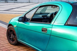 left side of small emerald coupe sportcar