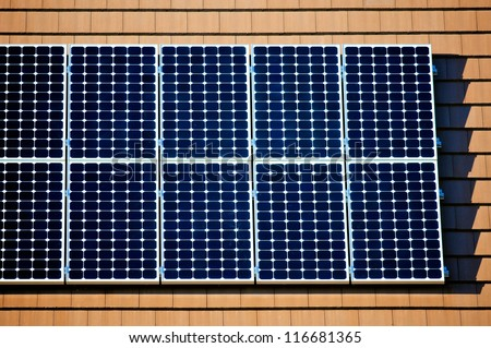 Left side of solar panels on the roof of a new home