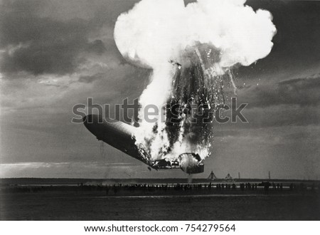 Left side view of German airship 'Hindenburg' burning, at Lakehurst, N.J., May 6, 1937. Hindenburg used flammable hydrogen for lift, which incinerated the airship in a massive fireball in less than 30 - Shutterstock ID 754279564