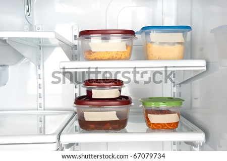 Leftovers in a refrigerator with blank tape for copy.