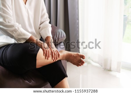 leg cramp, senior woman suffering from leg cramp pain at home, health problem concept #1155937288