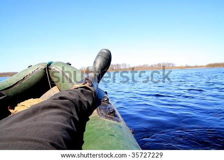 leg in rubber boat