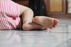 Leg of a girl sleep on the marble floor
