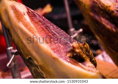 Leg of Spanish delicatessen jamon serrano ham at the farmers market stall