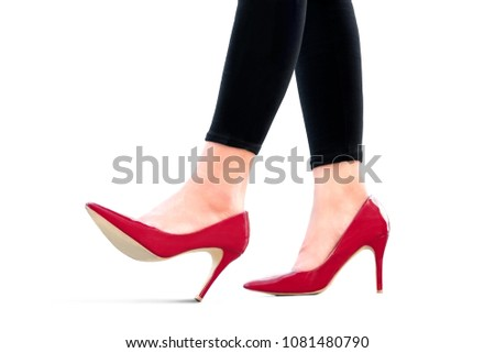 leg of woman beauty put on red high heels on isolated white background.Beauty and health concepts