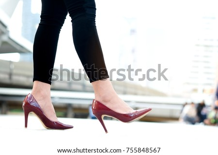 leg of woman beauty put on red high heels Walk on the street #755848567