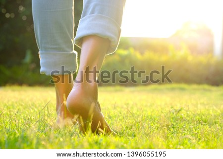 Leg of woman is on  to walk down the grass to exercise in the morning. Health and Relaxation Concepts ストックフォト ©