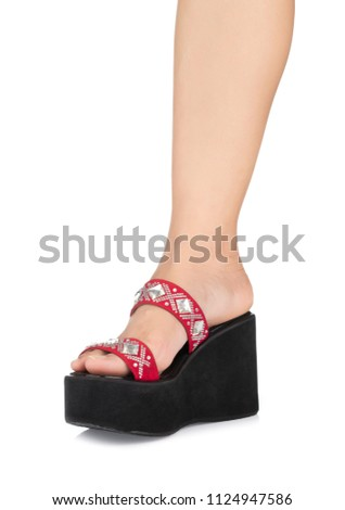 7adef395eee1 leg of women on wedge heels shoes sandals on platform isolated on white  background  1124947586