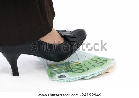 Leg stepping on banknotes (money under control - concept)