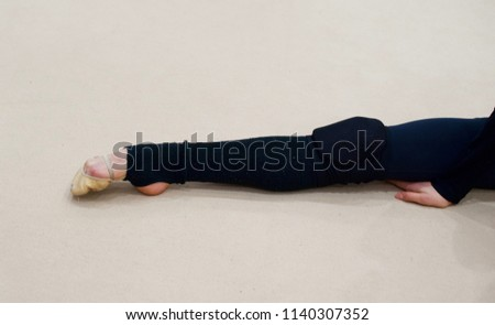 Leg with a foot in pointe - wearing toe shoes kneepads, Rhythmic gymnast, dancer
