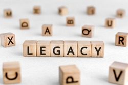 Legacy - words from wooden blocks with letters, money or property left to someone legacy concept, white background