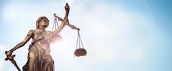 Legal and law concept statue of Lady Justice with scales of justice and sky background
