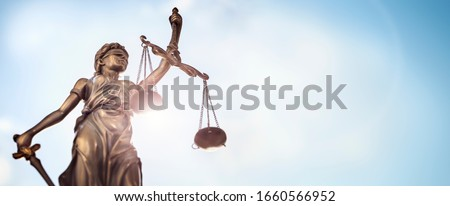 Legal and law concept statue of Lady Justice with scales of justice and sky background Photo stock ©