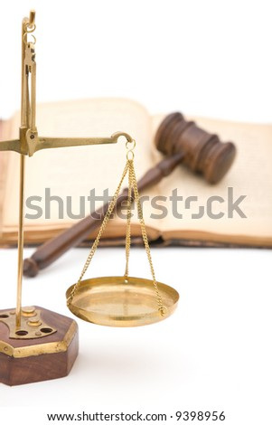 legal concept with old gavel, scales of justice and books on white background