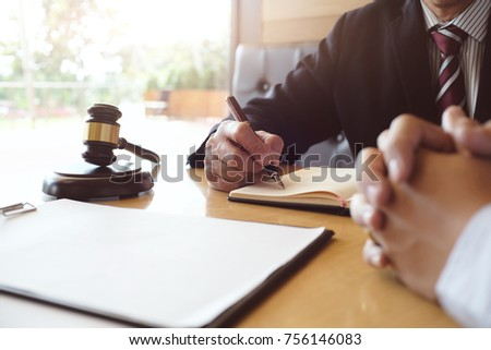 Legal counsel presents to the client a signed contract with gavel and legal law. justice and lawyer concept #756146083