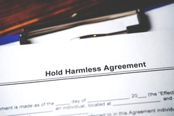 Legal document Hold Harmless Agreement on paper close up.