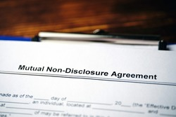 Legal document Mutual Non-Disclosure Agreement on paper
