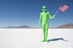 Legal (or illegal) alien making a patriotic immigration statement holding an American flag on dramatic lunar landscape