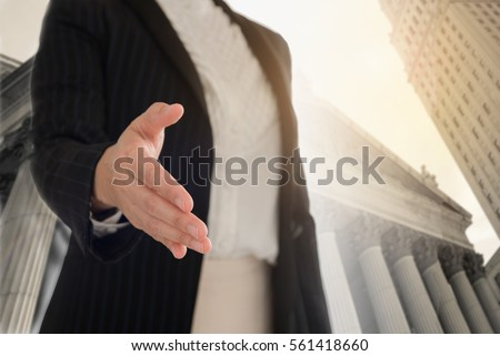 legal services. Female lawyer offering handshake with client for legal adviser. #561418660