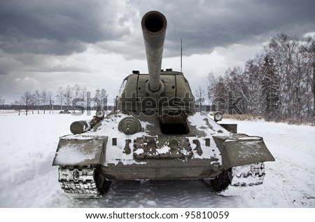 Legendary Russian Tank T34 under a dramatic sky. - stock photo