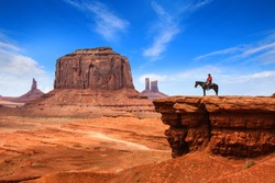 Legendary scene of a cowboy in Monument Valley (USA)