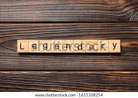 Legendary word written on wood block. Legendary text on wooden table for your desing, Top view concept. Zdjęcia stock ©