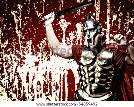 Legionary soldier over abstract bloody wall