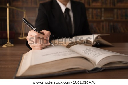 legislation, legal education concept. business lawyer reading law books to advice client.