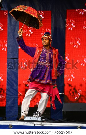 LEGNICA, POLAND - JUNE 30: An unidentified folklore dancer from India, performs during the International Festival of Ethnic and National Minorities on June 30, 2010 in Legnica, Poland.