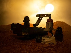 Lego star wars. The Jawa people are scavenging some scrap on the planet Tatooine during a sunset.