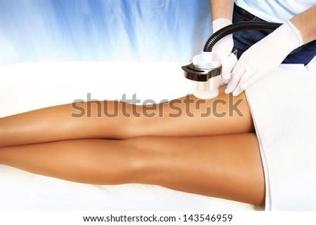 legs cellulite treatment in cosmetics salon - stock photo