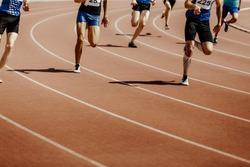 legs group runners sprinter men race 200 meters in stadium