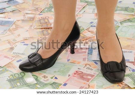 Legs in elegant shoes on euro banknotes (money under control and security concepts)