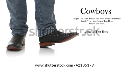 Legs in Jeans and Cowboys Boots with Text Space to the Right - stock photo