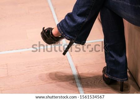 Legs of a woman sitting cross legged.