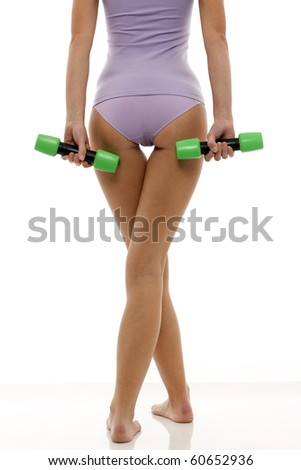 legs of a young caucasian woman in lingerie back with dumbbells in hand