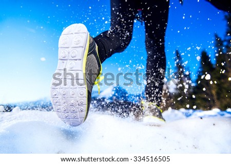 Legs of a young runner outside in winter nature