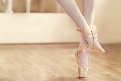 Legs of ballerina in ballet shoes, closeup