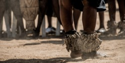 Legs Of Kalanga Traditional Dance Troupe Putting On Setswana Traditional Leg Rattles Performing On A Dusty Sand During A Wedding Ceremony In Botswana.