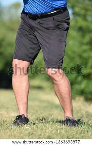 Legs Of Older Male Golfer