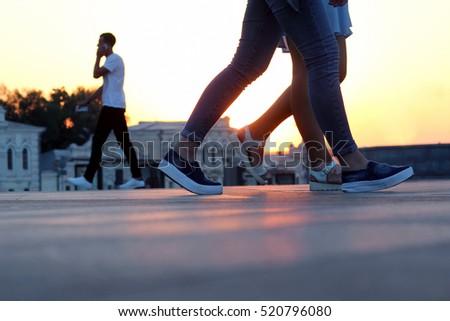 legs of people walking at sunset #520796080