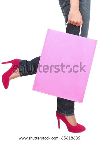 Legs of shopping lady showing shopping bag with copyspace. Isolated on white background.