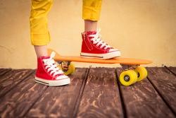 Legs of skateboarder. Closeup view