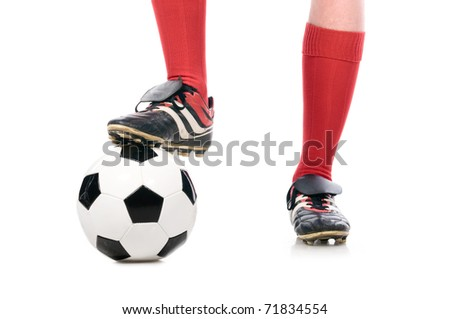 legs of soccer player close-up isolated on white