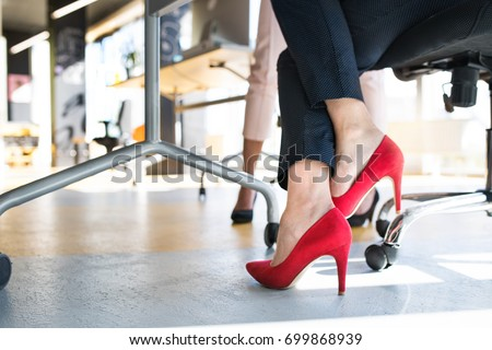Legs of unregognizable business women in high heels. #699868939