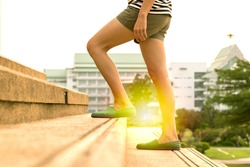 Legs of women walking up the stair in success concept